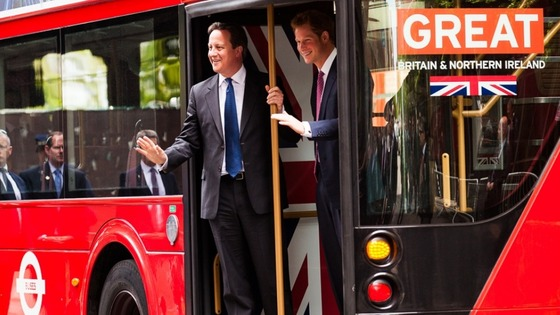 David Cameron and Prince Harry on the special edition bus