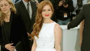 Isla Fisher poses for photographers in Cannes