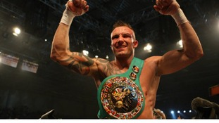 Mikkel Kessler celebrating with the belt after victory over Carl Froch