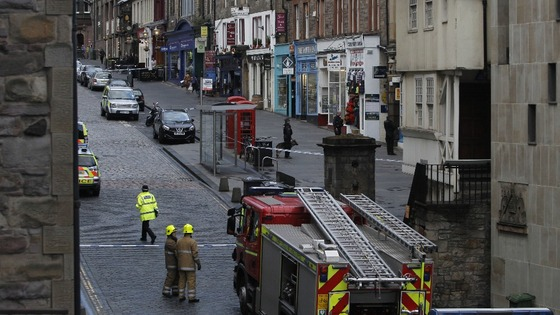 Police and firefighters at the scene of an incident on the Royal Mile in Edinburgh