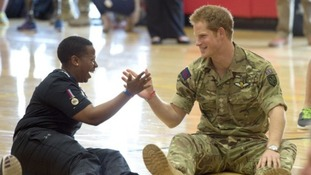 Prince Harry shakes hands with a soldier during a bout of 'Warrior Games'