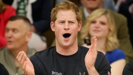 Prince Harry watches a seated volleyball exhibition match during the Warrior Games