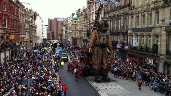Giant Diver puppet walks through Liverpool city centre 