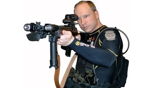 Anders Breivik posing as a policeman
