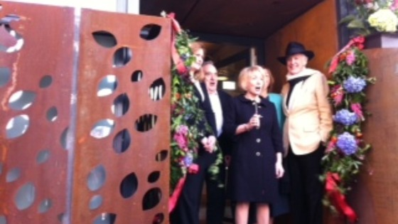 Charles Jencks, husband of Maggie, cuts the ribbon to officially open the centre.