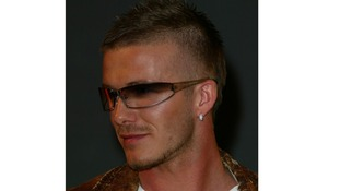 Beckham poses in 2002.