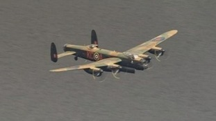 A Lancaster bomber flew over the Derwent reservoir today