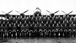 The 617 Squadron pictured in front of a Lancaster bomber