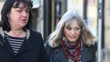 Mrs Marion Giles, 66, (right) walks into the inquest of her husband with her solicitor Mary Ann Charles.