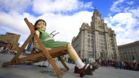 Little girl giant sleeps under Liver building