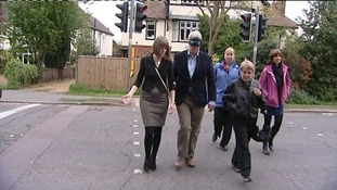 Andrew Lansley wearing blindfold walking across crossing