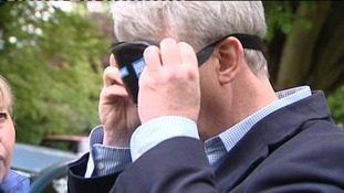 Andrew Lansley putting on a blindfold