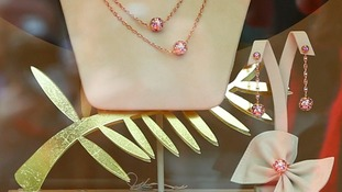 A model of the Golden Palm, made by Swiss jeweller Chopard, is seen in the window of a luxury jeweller in Cannes.