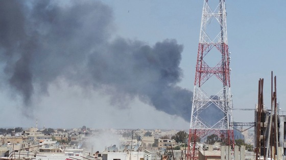Smoke rises after what activists said was a missiles fired by Syrian Air Force fighters loyal to President Assad in Deraa on April 26.