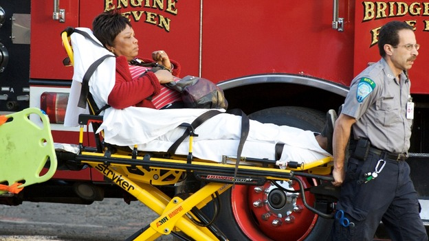 A woman is transported to the hospital