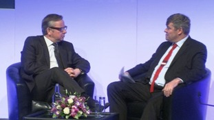 Education Secretary Michael Gove (L) speaks at the NAHT conference