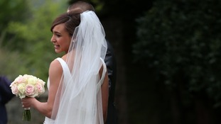 Jessica Ennis shows off her dress for the waiting media after the wedding