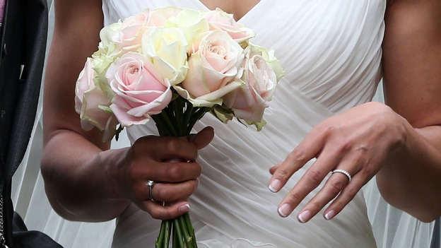 Jessica Ennis shows off her wedding ring and bouquet