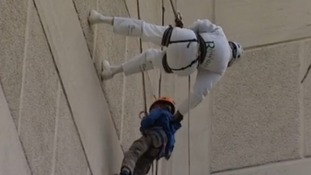 Pensioner abseils building 