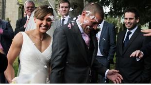 Well-wishers throw confetti at Jessica Ennis and her new husband, Andy Hill.