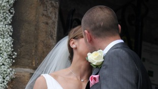 Jessica Ennis and her new husband Andy Hill share a kiss for the cameras.