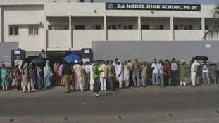 People queuing outside a polling station in Karachi, southern Pakistan.