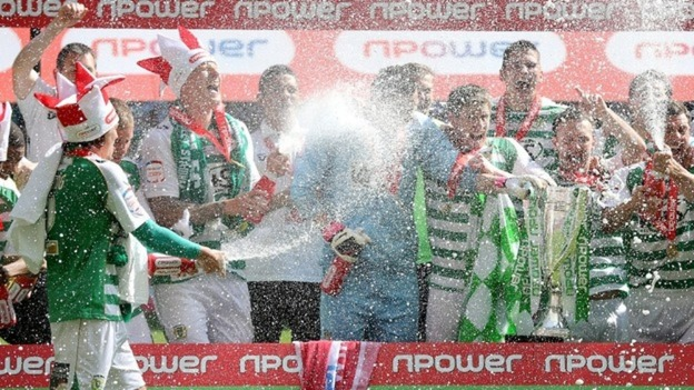 Yeovil Town players celebrate winning promotion to the Championship. 