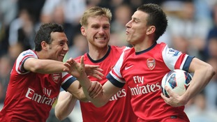 Arsenal Laurent Koscielny (right) celebrates scoring the opening goal.