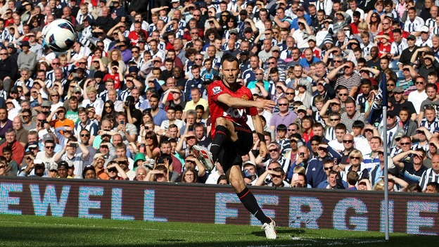 Manchester United&#x27;s Ryan Giggs takes a corner kick during the game against West Brom.