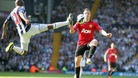 West Bromwich Albion's Youssouf Mulumbu and Manchester United's Alexander Buttner (right) battle for the ball
