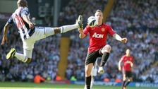 West Bromwich Albion&#x27;s Youssouf Mulumbu and Manchester United&#x27;s Alexander Buttner (right) battle for the ball