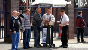 West Bromwich Albion fans buying match programmes outside The Hawthorns prior to kick-off, 20,000 were printed