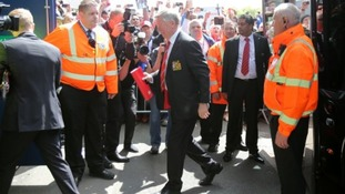Manchester United manager Sir Alex Ferguson gets off the team bus after arriving at The Hawtorns before the game