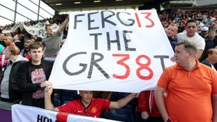 Manchester United fans honouring manager Sir Alex Ferguson in the stands