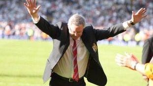 Manchester United manager Sir Alex Ferguson acknowledges the fans after his final game in charge of the club