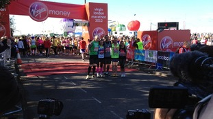 Marathon runners enjoy sunny start