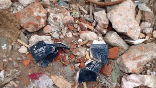 Labels from UK clothing company Premier in the rubble.