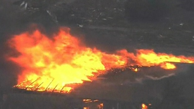 Aerial footage shows fires and flattened buildings after the tornado tore through
