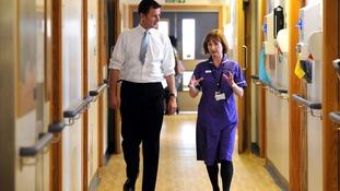 Health secretary Jeremy Hunt is shown around an NHS ward in London.