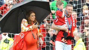 A heavily pregnant Coleen Rooney with husband Wayne Rooney and their son Kai pictured last week.