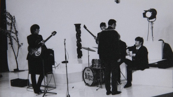 A copy of a photograph of The Beatles performing during a closed set filming session for their film 'A Hard Days Night'.