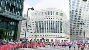 Charity donations replace share prices on the Thomson Reuters LCD ticker tape in Canary Wharf