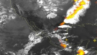 Thunderstorms and funnel clouds begin forming in this satellite image