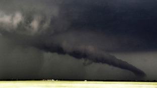 A giant funnel cloud almost makes landfall near South Haven in Kansas
