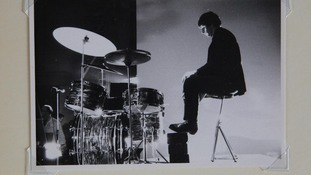 Ringo Starr resting his feet on bricks to boost his height in between takes.