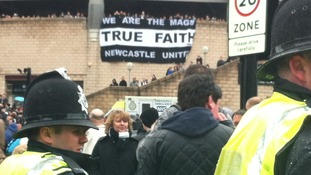 Police monitor the crowds outside St James' Park ahead of the Tyne Wear Derby