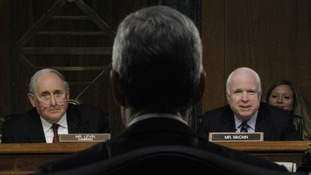 Apple's CEO faced Senator John McCain and Senator Carl Levin in a Congressional hearing
