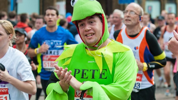 A runner in costume takes part in the 32nd Virgin London Marathon