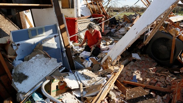 Charles Maloney tries to salvage papers from his tornado-destroyed home on Heather Lane in Moore.