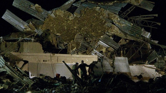 Rescue personnel combs through the pile of rubble that was once Plaza Towers Elementary School.